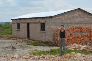 Leandra in front of the girls dormitory during construction