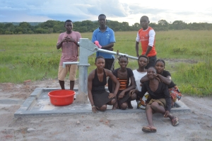 Several students in front of the new borehole
